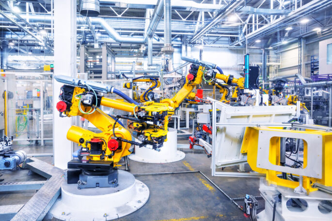 53747789 - robotic arms in a car plant